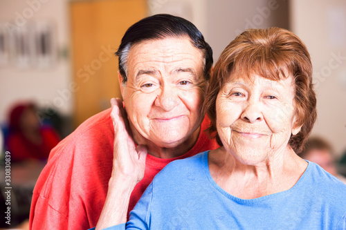 Photo Smiling Hispanic Couple in a Senior Center