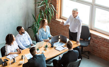 Employer Giving Speech On Meeting With Employees Sitting In Office