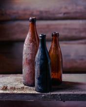 3 Dusty Old Empty Bottles In T...