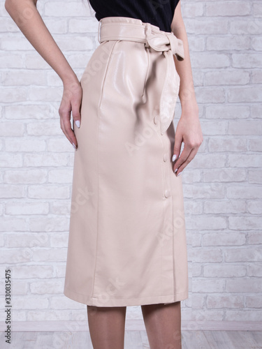 Fototapety, obrazy: Woman wearing beige leather skirt.