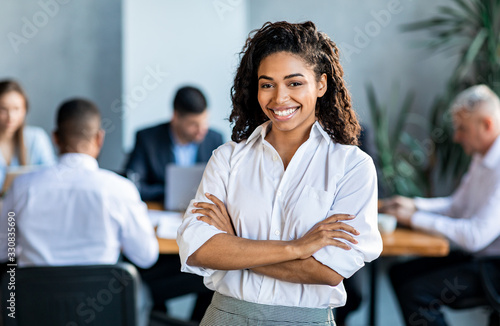 Canvastavla Black Businesswoman Smiling At Camera Posing Standing In Modern Office
