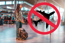 A Woman Stands With A Backpack At The Airport, Waiting For The Departure Of The Plane.Blurred.Prohibition Sign.The Concept Of A Ban On Flights, The Closure Of State Borders And The Virus Pandemic
