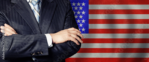 Businessman in a suit with his hands arms crossed on flag background Wallpaper Mural