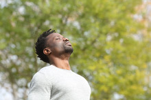 Black Serious Man Breathing Fresh Air In A Park