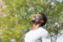 Happy Black Man Breathing Deeply Fresh Air In A Park