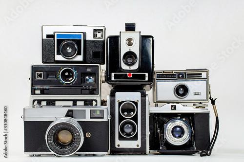 Valokuvatapetti collection of retro cameras on isolated background