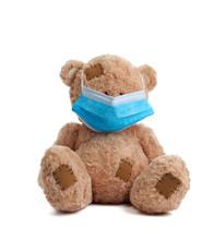 Big Teddy Bear Are Sitting In Blue Medical Masks