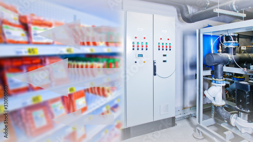 Fototapeta Refrigeration equipment. Refrigeration display case for food storage. Equipment management system. System for monitoring refrigerated counters. Large motor for cooling. Equipment for a supermarket obraz