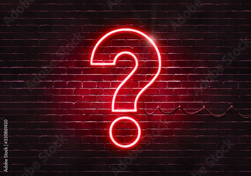 Photo Neon sign on a brick wall in the shape of a question mark