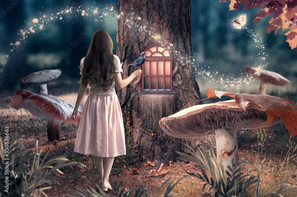 Fototapeta Girl in dress with bird in hand in fantasy enchanted fairy tale forest with giant mushrooms, magical shining window in pine tree hollow and flying magic butterfly leaving path with luminous sparkles