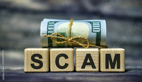 SCAM word concept on cubes with a dollar money Banknote Canvas Print
