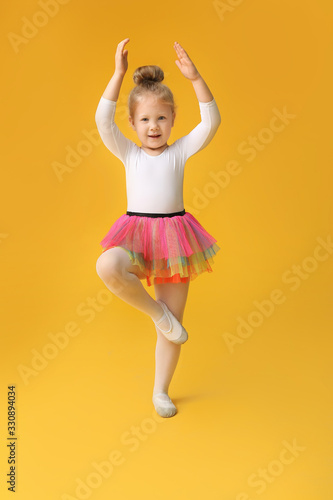 Cute little ballerina on color background Fototapeta