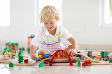 Kids Play Wooden Railway. Chil...