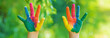 canvas print picture - child with painted hands and legs. Selective focus.