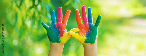 child with painted hands and legs. Selective focus.