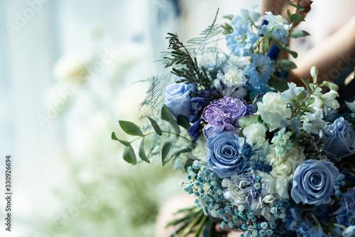 Fotografie, Obraz wedding bouquet of blue and purple flowers.