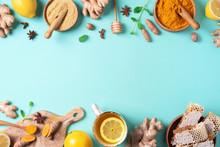Organic Ingredients For Turmeric Hot Tea On Blue Background. Antiviral Beverage. Healthy Ayurvedic Drink With Lemon, Ginger, Cinnamon, Turmeric. Immune Boosting Remedy