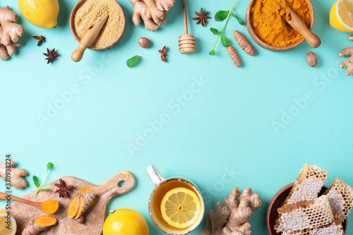 Canvas Print Organic ingredients for turmeric hot tea on blue background
