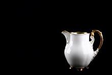 Porcelain Milk Jug On A Black ...