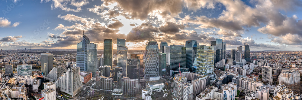 Fototapeta Aerial panoramic drone shot of La defense skyscraper in Paris with clouds and sunset