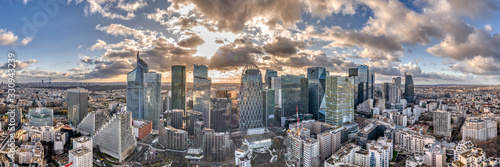 Fototapeta Aerial panoramic drone shot of La defense skyscraper in Paris with clouds and sunset obraz