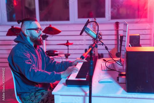 Professional musician recording synthesizer in digital studio at home, Music production technology concept Tapéta, Fotótapéta