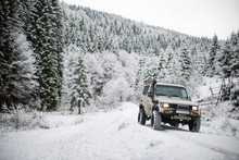 Off Road Car In Snowy Forest
