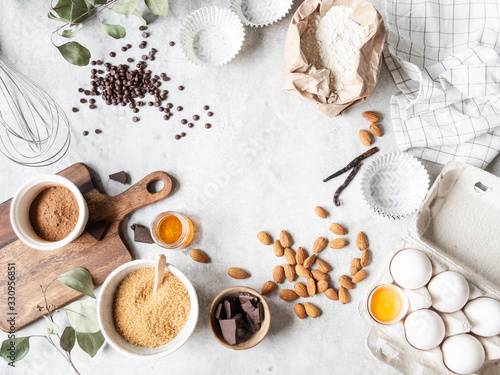 Fototapeta Cooking flat lay frame of various food ingredients for baking on a white background. Copy space. Top view. Baking concept. Mockup. obraz