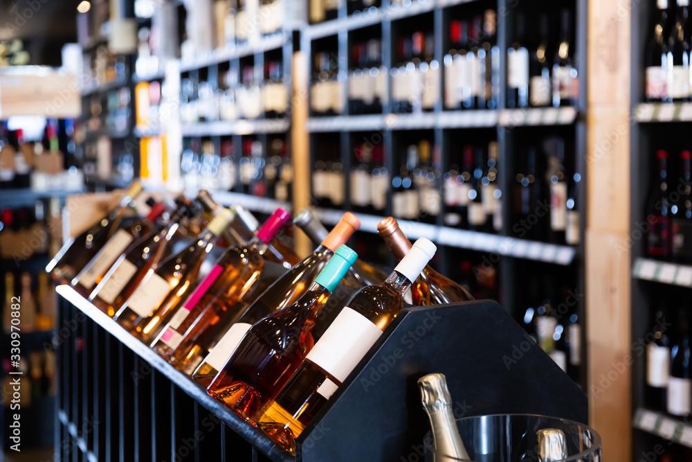 Fototapeta Quality wine bottles waiting for customers