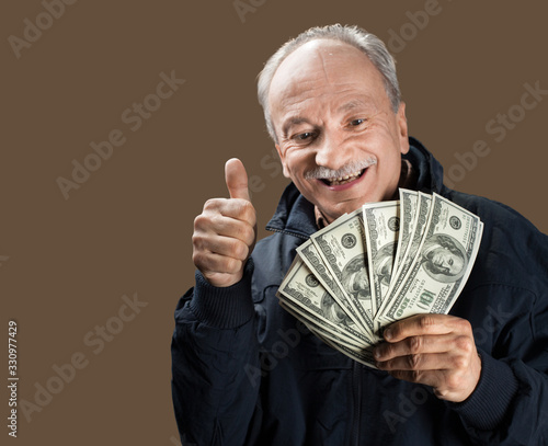 Senior gentleman holding a stack of money Canvas Print