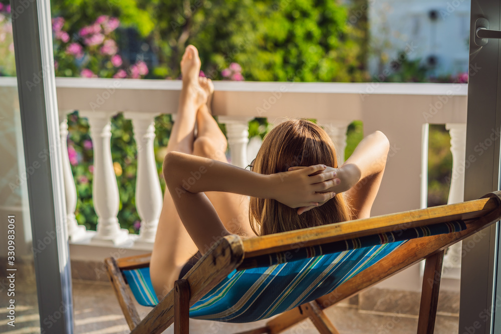 Fototapeta life-work balance, relaxation healthy quality living lifestyle in summer holiday vacation of freelancer woman take it easy resting in resort hotel balcony having peace of mind