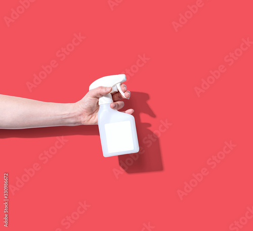 Photo White spray bottle - cleaning and hygiene concept