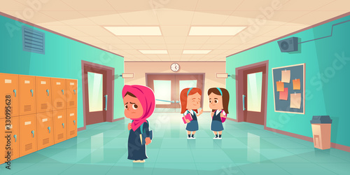 Valokuva Sad muslim girl in school hallway and teenagers behind her back