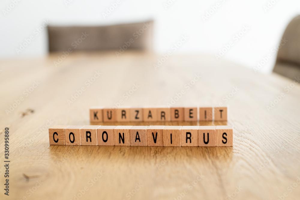 Fototapeta Coronavirus und Kurzarbeit-Konzeptbild