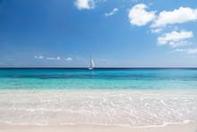 Sailboat And Tropical Beach