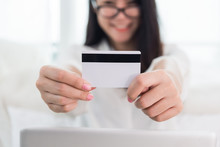 Young Asian Woman Use Credit Card For Online Shopping With Laptop. Business And Banking Payment Concept. Price Sale And Promotion Concept. Technology And Computer Theme. E-commerce And Marketing Theme
