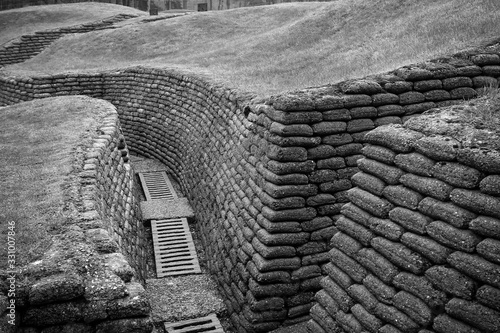 trenches with sandbag protection in a meadow that was once the battlefield in th Canvas Print