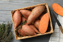 Sweet Potato In Basket On Wooden Background, Top View