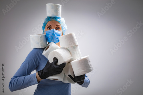 mata magnetyczna Coronavirus COVID-19 hysteria with toilet paper / illustrative presentation about real panic stockpiling.