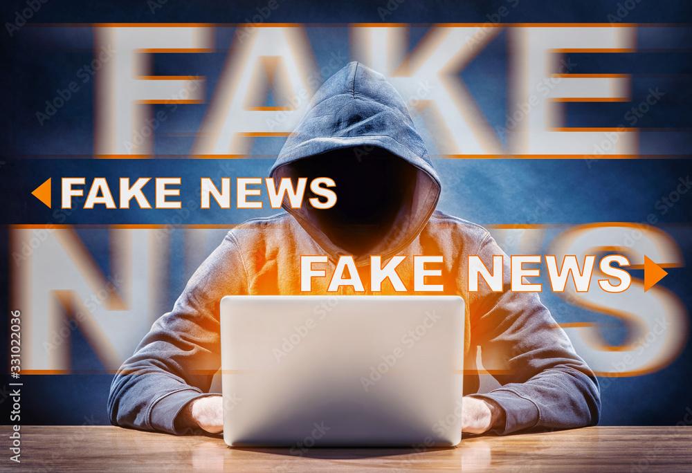 Fototapeta hacker spreading fake news from a computer