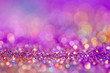 canvas print picture - Festive twinkle glitters background, abstract glowing backdrop with circles,modern design overlay with sparkling glimmers. Pink, purple and golden backdrop glittering sparks with blur effect