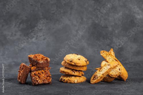 Sweet crispy nugatin biscotti cookies on dark surface Fototapete