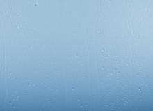 Raindrops On Glass Window Over...