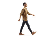 Casual Young Man In Shirt And Jeans Walking With A Smile
