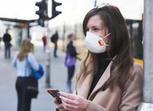 Coronavirus Disease - Woman Wearing Face Mask