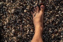 Barefoot Male Feet Stands On A...