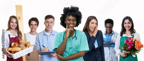 Lachende Krankenschwester mit anderen Azubis Canvas Print