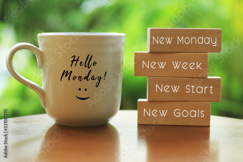 Fotografia Hello Monday concept with inspirational quote on wooden blocks - New Monday