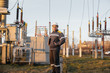 The energy engineer inspects the equipment of the substation. Power engineering. Industry