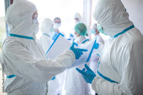 Obraz Epidemic outbreak - coronavirus. Exhausted medical staff.  - fototapety do salonu